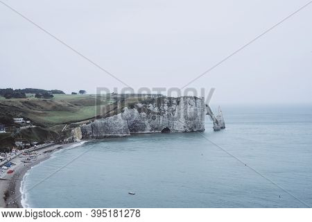 Coastal Landscape. Steep And Tall Rock Formation At The Coast Of Normandy, Etretat