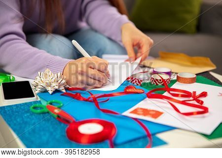 Close Up Female Hands Making Greeting Card For New Year And Christmas 2021 For Friends Or Family, Sc