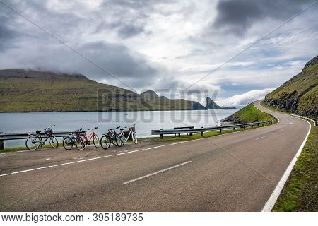 Bicycles Parked Near High Slope Iconic Road In Faroe Islands