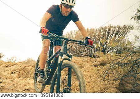 Cyclist In Violet Riding The Mountain Bike On The Spring Enduro Trail. Extreme Sport And Enduro Biki