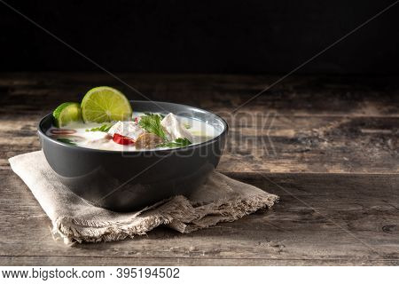 Traditional Thai Food Tom Kha Gai In Bowl On Wooden Table.copy Space