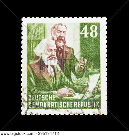 Cancelled Postage Stamp Printed By East Germany, That Shows Friedrich Engels And Karl Marx, Circa 19