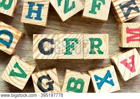 Alphabet Letter Block In Word Cfr (abbreviation Cost And Freight) With Another On Wood Background