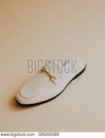 White lather loafer mules shoes on beige