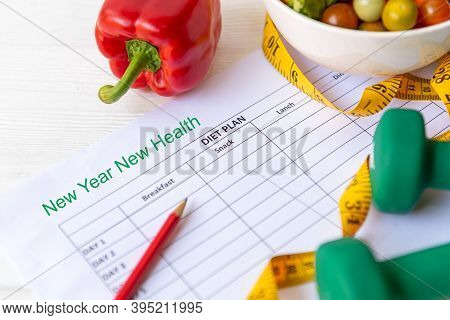 New Year For New Healthy 2021.  Fresh Vegetable Salad And Healthy Food For Sport Equipment For Women
