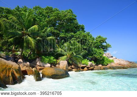 Coast with big granite boulders of the island La Digue, Anse Severe beach, Indian ocean, Seychelles. Tropical destination.