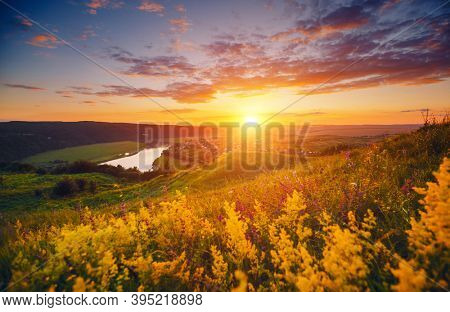 Incredible summer view of the sinuous Dniestr river in sundown. Location place Dnister river of Ukraine, Europe. Vibrant photo wallpaper. Exotic nature photography. Discover the beauty of earth.