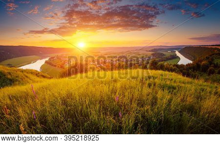 Fresh summer view of the sinuous Dniestr river in sundown. Location place Dnister river of Ukraine, Europe. Vibrant photo wallpaper. Exotic nature photography. Discover the beauty of earth.