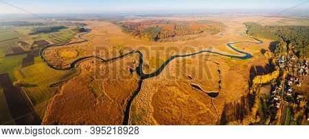 Attractive view from a drone flying over the sinuous river. Location Polissya region of Ukraine, Europe. Exotic photo wallpaper. Picturesque nature photography. Discover the beauty of earth.