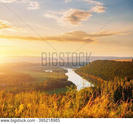 Stunning view of the sinuous Dniestr river in sundown. Location place Dnister river of Ukraine, Europe. Vibrant photo wallpaper. Exotic nature photography. Discover the beauty of earth.