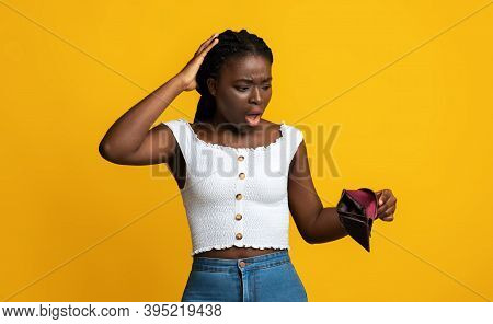 Oh No. Shocked Black Woman Looking At Empty Wallet In Her Hands And Touching Head, Suffering From Po