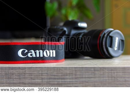 Brecht, Belgium - April 30 2020: A Portrait Of A Camera Strap Of The Canon Company Lying On A Table