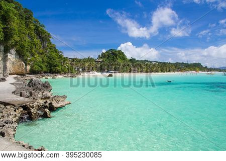 View Of A Beautiful Tropical Beach. The Path Along The Sea To The White Beach. Beach Vacation, White