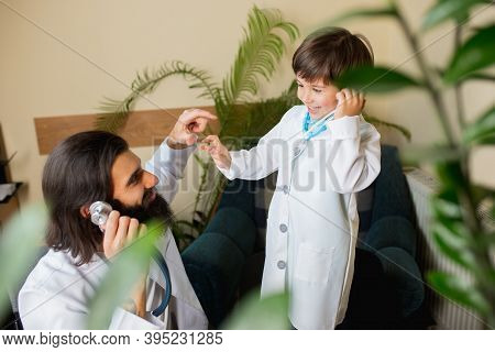 Paediatrician Doctor Examining A Child In Comfortabe Medical Office. Healthcare, Childhood, Medicine