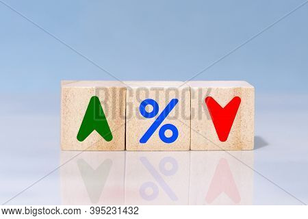 Wooden Cube Block With Icon Percentage, Symbol Arrow Up And Down. Interest Financial And Mortgage Ra