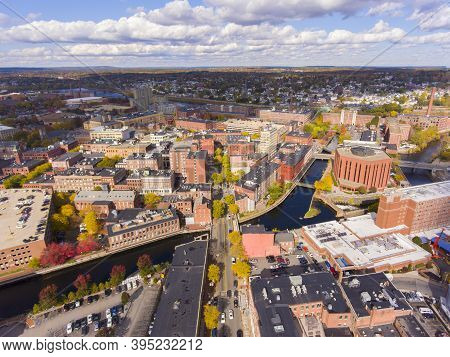 Lowell Historic Downtown, Canal, Marrimack River And Historic Mills Aerial View In Fall In Lowell, M