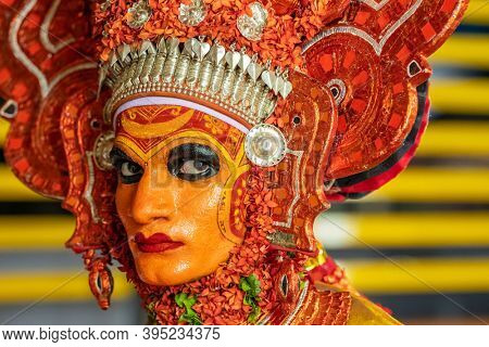 Payyanur, India - December 4, 2019: Theyyam artist perform during temple festival in Payyanur, Kerala, India. Theyyam is a popular ritual form of worship in Kerala, India