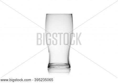Empty Beer Glass Isolated On A White Background Without Glare. Reflection On The Surface. Back Light