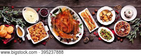Traditional Christmas Turkey Dinner. Top View Panoramic Table Scene On A Dark Wood Banner Background