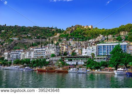 Turkey, Alanya - October 22, 2020: Peninsula With Modern Cottages And Ancient Alanya Kalesi On Hillt