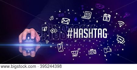 hand holding wireless peripheral with #HASHTAG inscription, social media concept