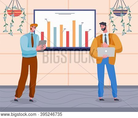 Confident Smiling Businessmen Wearing Office Suits Holding Laptop And Tablet In Hands And Show Prese