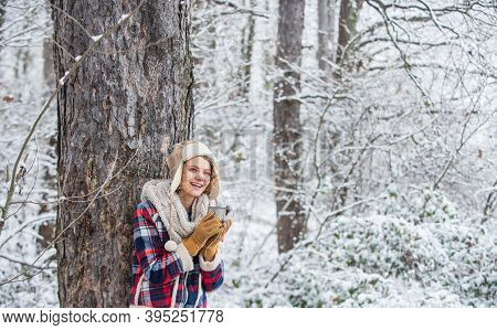 Woman In Hat Drinking Tea In Forest. Hiking And Traveling. Girl Hiker Drink Cup Of Hot Coffee. Winte