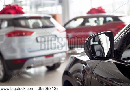 New Modern Cars With Blur Background. Car Auto Dealership. Prestigious Vehicles.