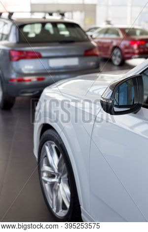 Car Auto Dealership. Themed Blur Background With Bokeh Effect. New Modern Cars At Dealer Showroom.