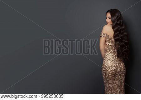 Nice Woman With Long Perfect Hair On Black Background