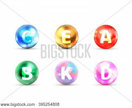 Set Of Bright Glossy Icons Of Vitamins A B C D E, K On White
