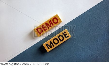 Concept Words 'demo Mode' On Wooden Blocks On A Beautiful Blue And Whute Background. Copy Space. Bus