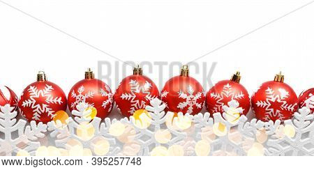 Red Christmas Balls With Snowflakes And Gold Lights Isolated On White Background