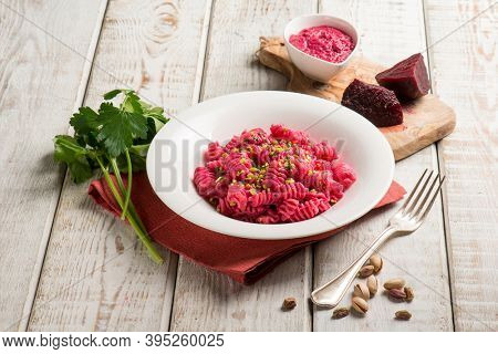 pasta with beet pesto and pistachio nuts