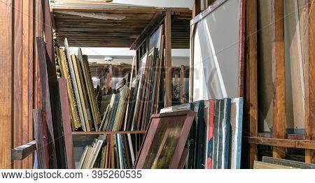 Batumi, Georgia, October, 26, 2020: Batumi Art Museum Storge, Wooden Shelves Full Of Pictures