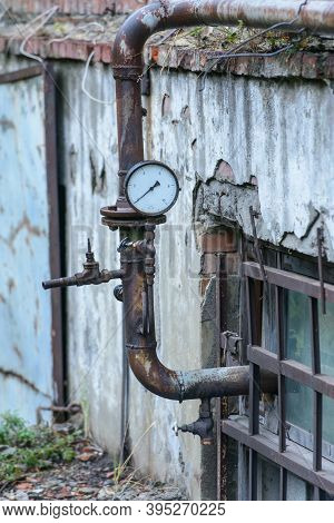 Old Metal Pipes With Valves And A Manometer