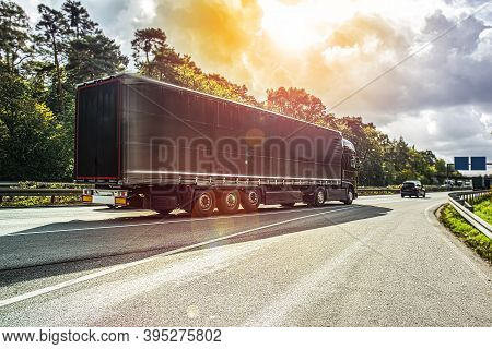 Motion Blurred Trucks On Highway.   Logistics And Transportation . Car Traffic On The Freeway, Europ