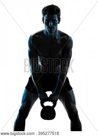 one caucasian young man exercIsing fitness Kettle Bell exercise in studio shadow silhouette isolated on white background