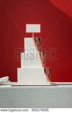 Big White Layered Square Cake On A Red Background