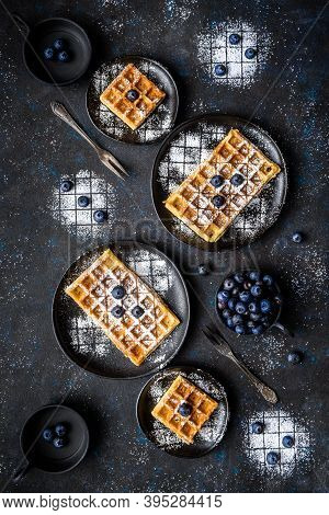 Sourdough Waffles Dusted With Sugar And With Blueberries As Toppings