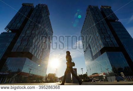 Bucharest, Romania - October 21, 2020: People Walk In Front Of The City Gate Towers Situated In Free