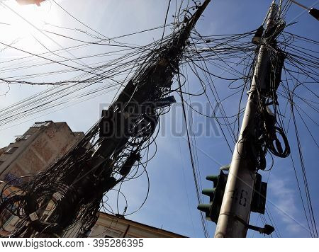 Bucharest, Romania - September 20, 2020: Many Internet And Communications Cables Hang Out On Pillars