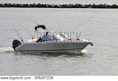 Fisherman Trolling Frm A High-end Runabout Motor Boat On Government Cut Off Of Southepointe Park In