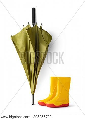 green umbrella and gumboots on white background