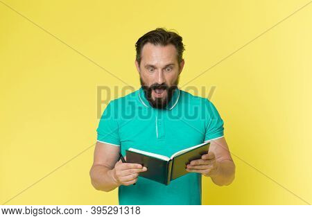 Surprise Concept. Bearded Man Shocked With Surprise. Senior Man Reading Book With Surprise. Real Sur