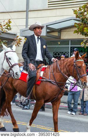 SAN FRANCISCO, USA - OCTOBER 11, 2009: Columbus Day celebration in San Francisco. Equestrian parade in national holiday. Dressy riders in cowboy hats riding on well-groomed horses.