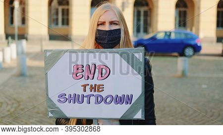 Concerned Woman In Protective Mask With Protest Banner Calling To End Shutdown By Walking On The Cit