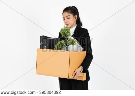 Fired Unemployed Young Asian Business Woman In Suit Holding Box With Personal Belongings On White Is