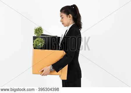 Side View Of Fired Dismissal Unemployed Young Asian Business Woman In Suit Holding Box With Personal