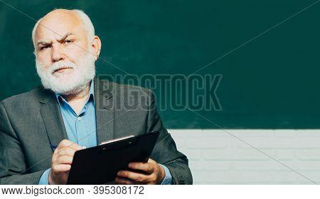 Teachers Day, Professor Knowledge And Educational School Concept. World Teachers Day. Portrait Of Ma